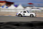 Automotive Car Photographer and Videographer Randy Wells, Image of a Porsche 911 racing at Rennsport Reunion IV, Laguna Seca, California, America west coast