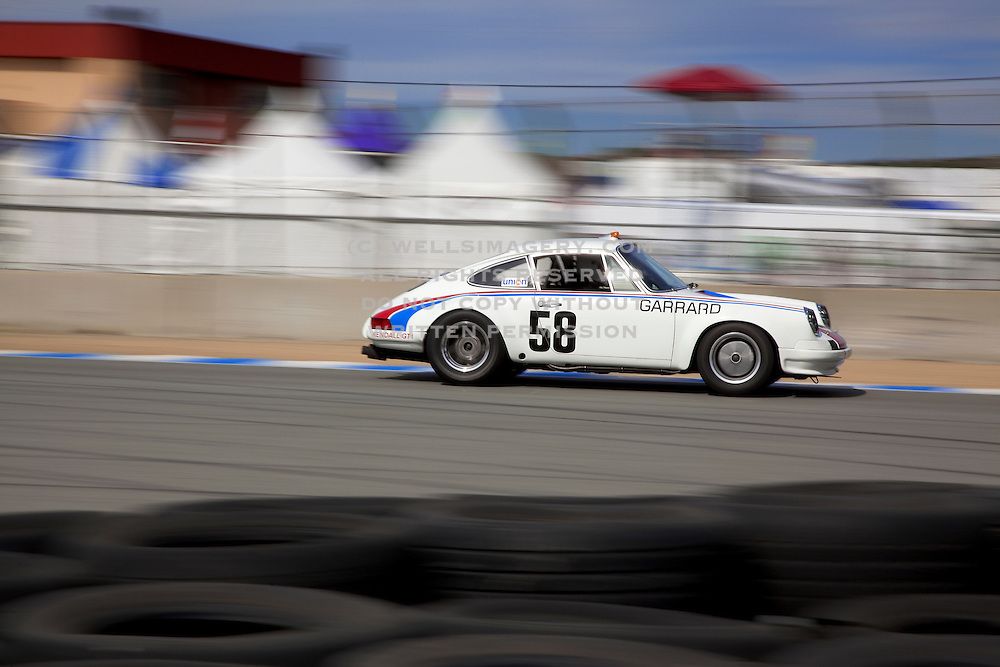 Automotive Car Photographer and Videographer Randy Wells, Image of a Porsche 911 racing at Rennsport Reunion IV, Laguna Seca, California, America west coast