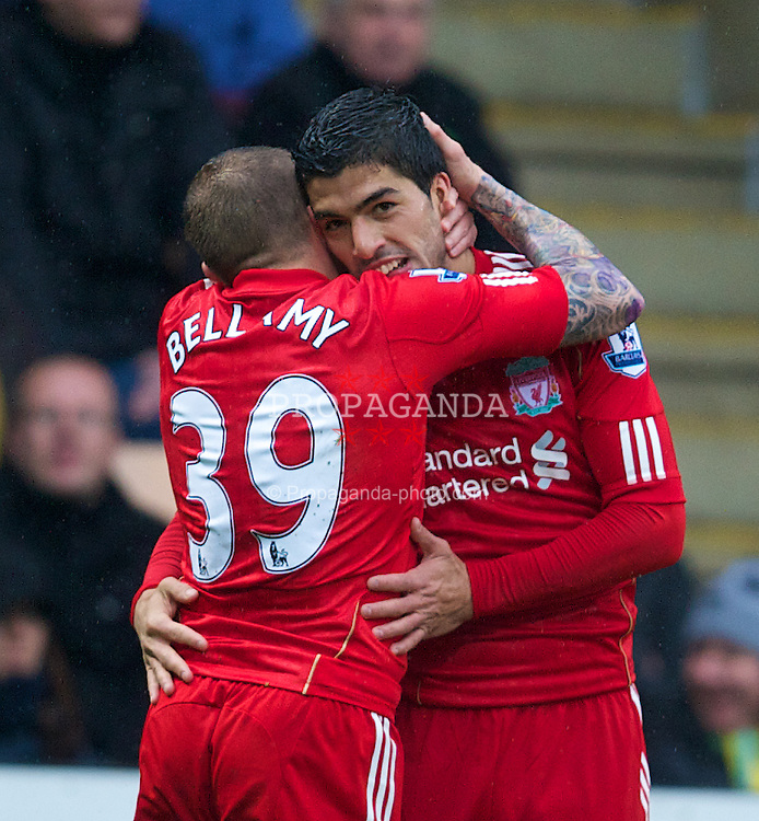 NORWICH, ENGLAND - Saturday, April 28, 2012: Liverpool's Luis Alberto Suarez Diaz celebrates scoring the second goal of his hat-trick against Norwich City with team-mate Craig Bellamy during the Premiership match at Carrow Road. (Pic by David Rawcliffe/Propaganda)