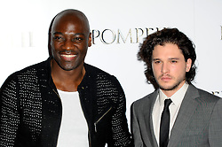 (L-R) Adewale Akinnuoye-Agbaje and Kit Harrington attends the VIP screening of 'Pompeii' at Vue West End, London, United Kingdom. Monday, 28th April 2014. Picture by Chris Joseph / i-Images