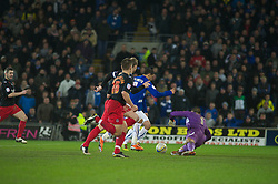 CARDIFF, WALES - Tuesday, February 1, 2011: Cardiff City's Jay Bothroyd takes the ball round Reading's Adam Federici to score the equalising goal during the Football League Championship match at the Cardiff City Stadium. (Photo by Gareth Davies/Propaganda)