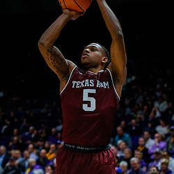 Jan 23, 2018; Baton Rouge, LA, USA; Texas A&M Aggies guard Savion Flagg (5) shoots against the LSU Tigers during the first half at the Pete Maravich Assembly Center. Mandatory Credit: Derick E. Hingle-USA TODAY Sports