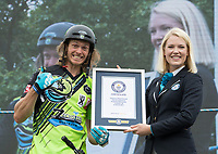Stunt cyclist Rick Koekoek is presented with a Guinness World Record certificate following his World Record he completed in the London Trials Championships, presented by Buxton, at this year's Prudential RideLondon FreeCycle 29/07/2017<br /> <br /> Photo: Tom Lovelock/Silverhub for Prudential RideLondon<br /> <br /> Prudential RideLondon is the world's greatest festival of cycling, involving 100,000+ cyclists – from Olympic champions to a free family fun ride - riding in events over closed roads in London and Surrey over the weekend of 28th to 30th July 2017. <br /> <br /> See www.PrudentialRideLondon.co.uk for more.<br /> <br /> For further information: media@londonmarathonevents.co.uk