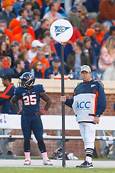 Oct 22, 2011; Charlottesville VA, USA;  Virginia Cavaliers running back Kevin Parks (25) stands next to an ACC distance marker linesman on the sidelines during the third quarter against the North Carolina State Wolfpack at Scott Stadium.  North Carolina State defeated Virginia 28-14. Mandatory Credit: Jason O. Watson-US PRESSWIRE