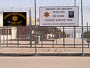 "27 FEBRUARY 2012 - PHOENIX, AZ:    The sign that marks the numbers of inmates who ""served"" in the Maricopa County Jail system's ""Tent City."" Maricopa County Sheriff Sheriff Joe Arpaio opened ""Tent City"" with surplus US Army tents from the Korean War in 1993. The tents, which are not air conditioned, house about 2,000 county inmates at any given time. Monday's announcement is the kickoff event of the Sheriff's celebration of 19 years of Tent City. The sign Arpaio  announced Monday is based on the sign a popular fast food chain used to use to mark the number of hamburgers served. PHOTO BY JACK KURTZ"