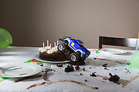 Toy car driven into birthday cake