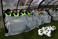 CANBERRA, AUSTRALIA - OCTOBER 10: The Nepal bench tries to keep warm during the FIFA World Cup Qualifier soccer match between Australia and Nepal on October 10, 2019 at GIO Stadium in Canberra, Australia. (Photo by Speed Media/Icon Sportswire)