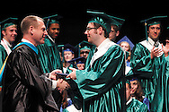 CJ president Daniel J. Meixner (class of 1984) presents a diploma to Trevor Meyers during the Chaminade Julienne High School Class of 2012 commencement exercises at the Schuster Center in downtown Dayton, Monday, May 21, 2012.