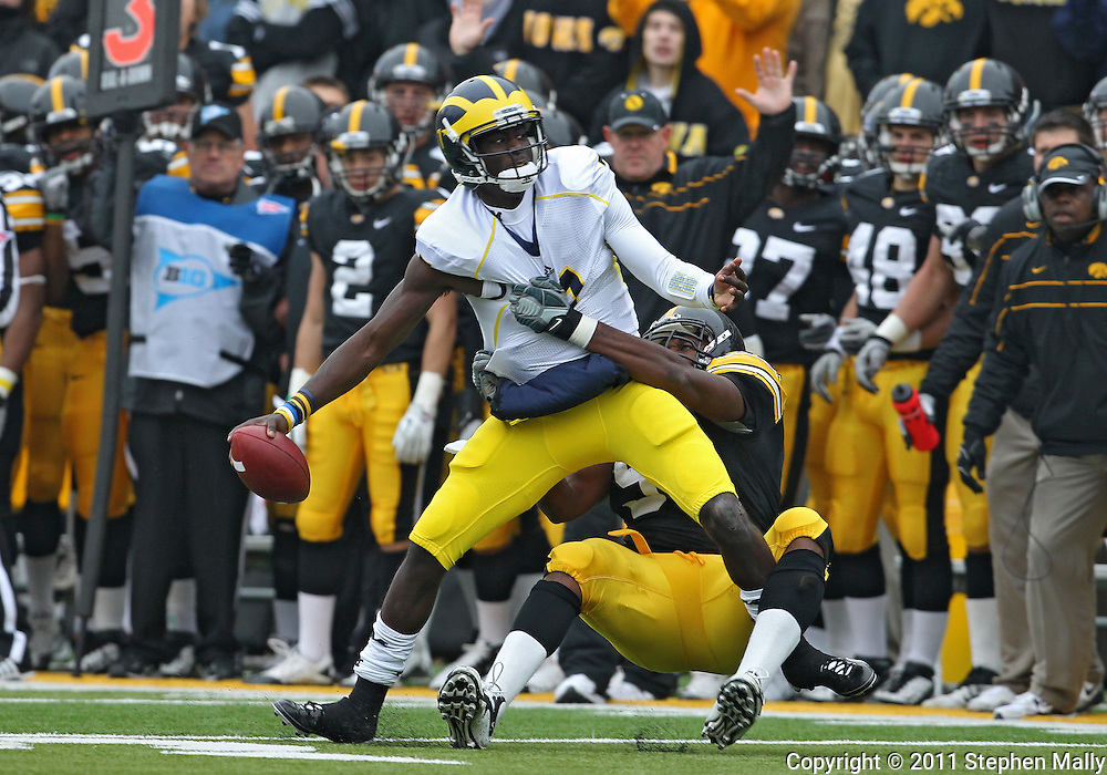 November 05, 2011: Iowa Hawkeyes defensive lineman Broderick Binns (91) sacks Michigan Wolverines quarterback Devin Gardner (7) during the second half of the NCAA football game between the Michigan Wolverines and the Iowa Hawkeyes at Kinnick Stadium in Iowa City, Iowa on Saturday, November 5, 2011. Iowa defeated Michigan 24-16.
