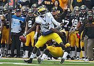 November 05, 2011: Iowa Hawkeyes defensive lineman Broderick Binns (91) sacks Michigan Wolverines quarterback Devin Gardner (7) during the second half of the NCAA football game between the Michigan Wolverines and the Iowa Hawkeyes at Kinnick Stadium in Iowa City, Iowa on Saturday, November 5, 2011. Iowa defeated Michigan 24-16.