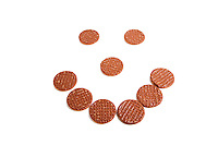 Biscuits arranged in shape of smiley face over white background