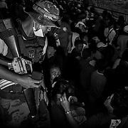 Philippines, Mindanao. Davao Oriental 2012. <br /> Anti riot army keep under control the situation inside evacuation center at New Bataan Stadium.