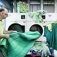 Nederland,Amsterdam ,13 november 2008..Groene was bij Stomerij Groen..wasserij, wasserette, stomerij