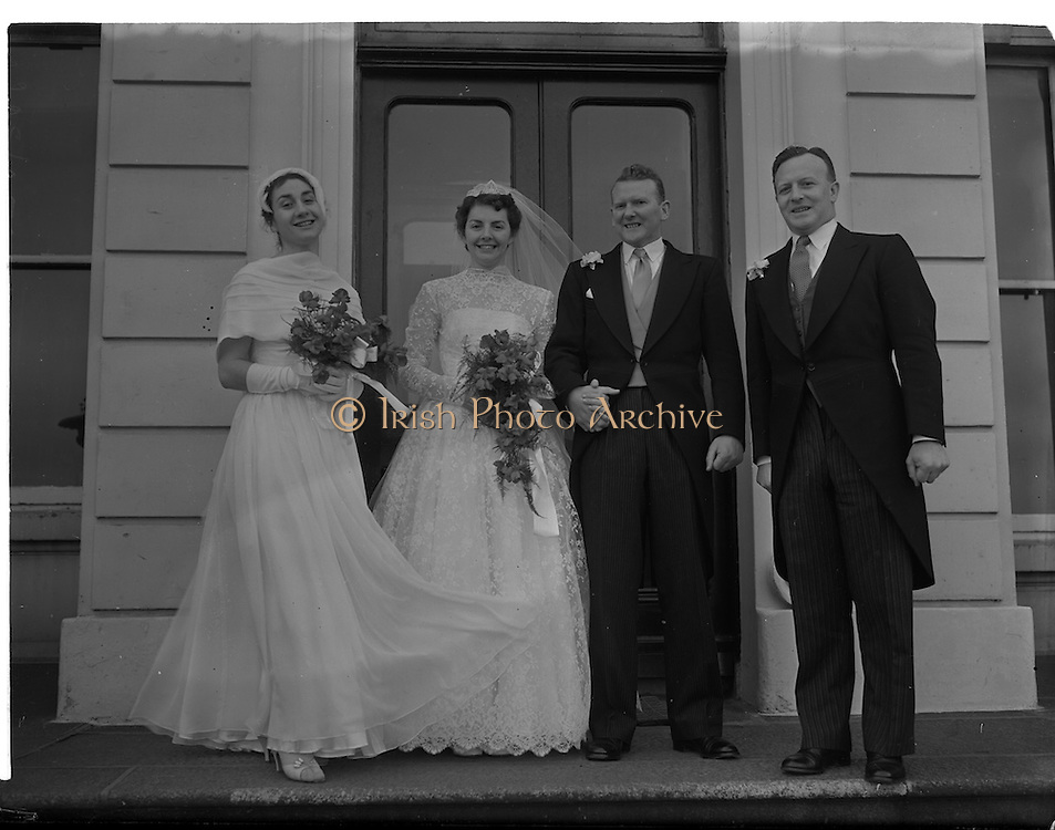 18/02/1957<br /> 02/18/1957<br /> 18 February 1957<br /> Wedding Dr K. Murphy and J. Fitzgerald at St. Mary's Church, Haddington Road and reception at Salthill Hotel, Monkstown. Bride and Groom  and Bridesmaid and Bestman outside the hotel..
