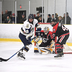 TORONTO, ON  - APR 10,  2018: Ontario Junior Hockey League, South West Conference Championship Series. Game seven of the best of seven series between Georgetown Raiders and the Toronto Patriots. Lee Lapid #8 of the Toronto Patriots battles for control with Jaden Condotta #40 of the Georgetown Raiders during the first period.<br /> (Photo by Andy Corneau / OJHL Images)