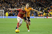 Wolverhampton Wanderers midfielder Dave Edwards and Nottingham Forest midfielder Ben Osborn in action during the Sky Bet Championship match between Wolverhampton Wanderers and Nottingham Forest at Molineux, Wolverhampton, England on 11 December 2015. Photo by Alan Franklin.