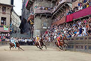 Italy, Siena, the Palio:from right , Chiocciola, MOntone Onda.  At the shot of the mortaretto, the horses come out of the Entrone and line up at the starting line, known as the mossa. As soon as the last horse reaches the starting line the race begins and lasts for three rounds of the square (about 1 kilometre in total). The first horse to cross the finishing line is the winner, regardless of whether it is still mounted.