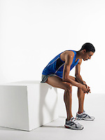 Athlete sitting on box side view