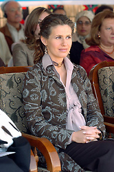 File photo - Syria's First Lady Asma El Assad receives a doctorate degree Honoris Causa' from the Faculty of Archeology of Rome's La Sapienza University at the historic site of Ebla October 20, 2004. The board of the Italian university was 'transported' to north of Syria, to award her this degree, it is the first time the university does so. Italian archeologic missions have discovered this site of Ebla kingdom and are still excavating some of the mankind treasures. Syria's British-born first lady Asma Assad has begun treatment for breast cancer. The Syrian presidency posted on its Facebook page a photo of President Bashar Assad sitting next to his wife in a hospital room. Photo by Ammar Abd Rabbo/ABACA.