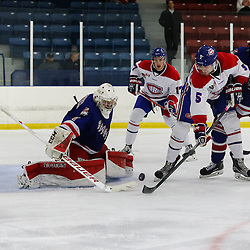 TORONTO, ON - OCT 19:  Goaltender, Jeremie Lintner #1 of the North York Rangers, makes the save on Scott Docherty #5 of the Toronto Jr. Canadiens, during the OJHL regular season game between the Toronto Junior Canadiens  and North York Rangers. on October 19, 2016 in Toronto, Ontario. (Photo by Anna Matthews / OJHL Images)
