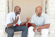 Two African men enjoying a joke together