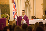 Father Xavier Osvaldo, saying mass at St. Ann's Catholic Church in Shoreditch. The congregation for 12 noon mass on sunday is almost exclusively Brazilian.