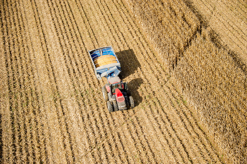 Aerial of a tractor hauling harvested corn in Centerville MD