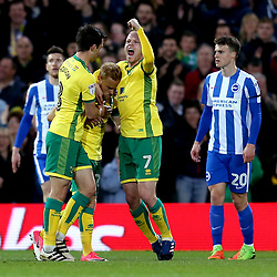 Alex Pritchard of Norwich City celebrates with teammates after scoring a goal to make it 1-0 - Mandatory by-line: Robbie Stephenson/JMP - 21/04/2017 - FOOTBALL - Carrow Road - Norwich, England - Norwich City v Brighton and Hove Albion - Sky Bet Championship