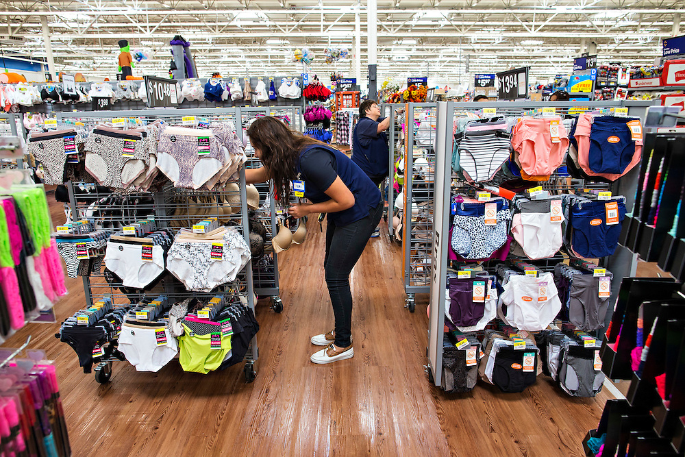 ROGERS, AR - OCTOBER 12:  Associates Esmeralda Gonzalez and Connie Cheatham arrange bras and underwear in the Intimate Department at Walmart Store #4208 on October 12, 2015 in Rogers, Arkansas.  <br /> CREDIT Wesley Hitt for Wall Street Journal<br /> WALSQUEEZE