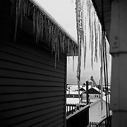 Icicles on houses, Schumacher, Ontario. From the book Cage Call: Life and Death in the Hard Rock Mining Belt. An in-depth project spanning over 12-years examining communities in one of the richest mining regions in the world located in Northwestern Ontario and Northeastern Quebec in Canada.