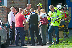 © Licensed to London News Pictures. 20/08/2019.<br /> Orpington ,UK. London Fire Brigade, Police and the London Ambulance Service are all in attendence this morning at a serious flat fire in Petten Grove, Orpington, South East London which has seen three people taken to hospital suffering from smoke inhalation one of the three is a child. A police cordon is in place as fire investigation officers work on scene. Photo credit: Grant Falvey/LNP