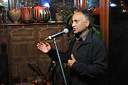 Birmingham, England. 23rd. October, 2016. <br /> Raj Pal, introducing the performers at 'Up Close and Personal' concert, featuring singers Dave Rogers and Arieb Azhar as part of the Bridges Across Borders series of events in Kings Heath Birmingham.<br /> Photographer, Kevin Hayes