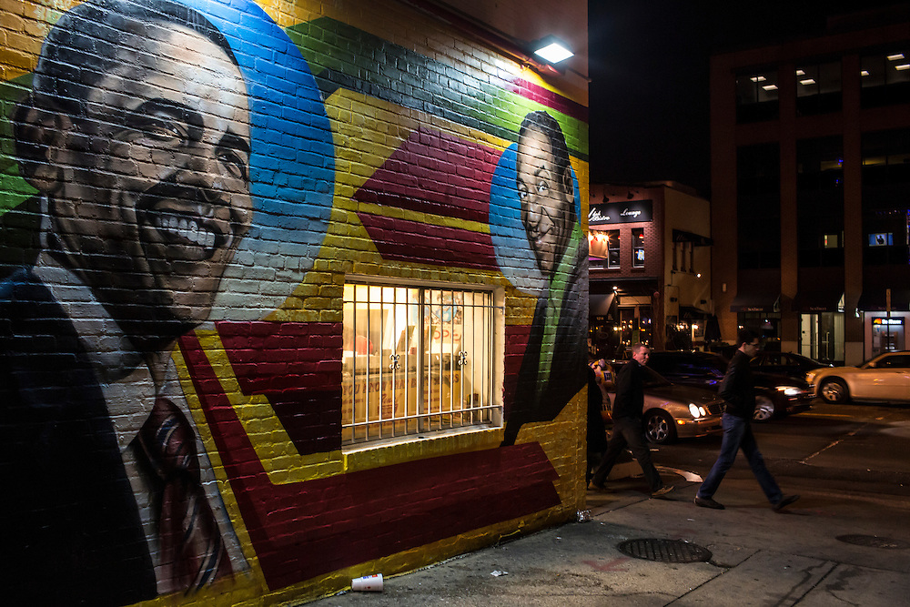 A mural of President Barack Obama is paired with one of Bill Cosby on the side of Ben's Chili Bowl on Monday, January 21, 2013 in Washington, DC.