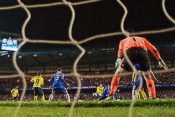 LONDON, ENGLAND - Wednesday, May 6, 2009: Barcelona's match-winner Andres Iniesta scores a dramatic injury time winning away goal past Chelsea's goalkeeper Petr Cech during the UEFA Champions League Semi-Final 2nd Leg match at Stamford Bridge. (Photo by David Rawcliffe/Propaganda)