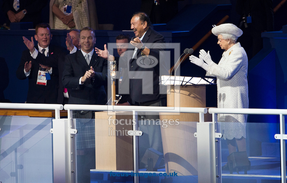 President of the Commonwealth Games Federation Prince Imran ( C ) opens the Queens baton during the Glasgow 2014 Commonwealth Games Opening Ceremony at Celtic Park, Glasgow<br /> Picture by Paul Terry/Focus Images Ltd +44 7545 642257<br /> 23/07/2014