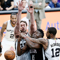 03 May 2017: Houston Rockets center Clint Capela (15) is fouled by San Antonio Spurs forward LaMarcus Aldridge (12) past San Antonio Spurs center Pau Gasol (16)  during the San Antonio Spurs 121-96 victory over the Houston Rockets, in game 2 of the Western Conference Semi Finals, at the AT&T Center, San Antonio, Texas, USA.