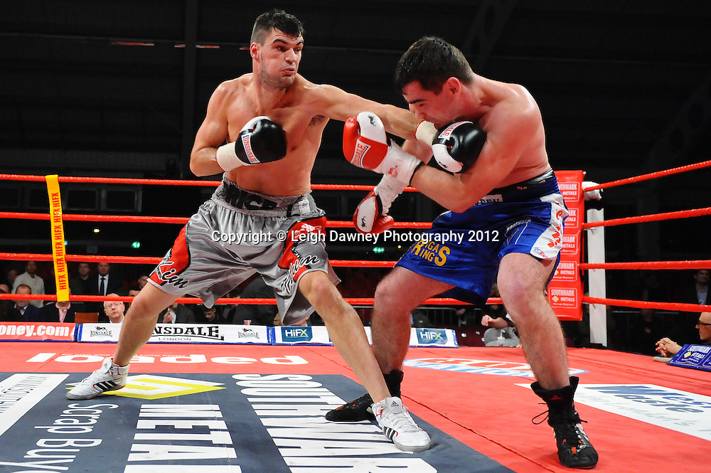 Danny Price (silver shorts) defeats Jevgenijs Andrejevs in a 6x3 Cruiserweight contest on the 30th November 2012 at Aintree Equestrian Centre, Aintree, Liverpool. Frank Maloney Promotions. Pictures by Leigh Dawney. ©leighdawneyphotography 2012.