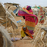 Refugees outside their makeshift shelters in Otash camp, South Darfur.