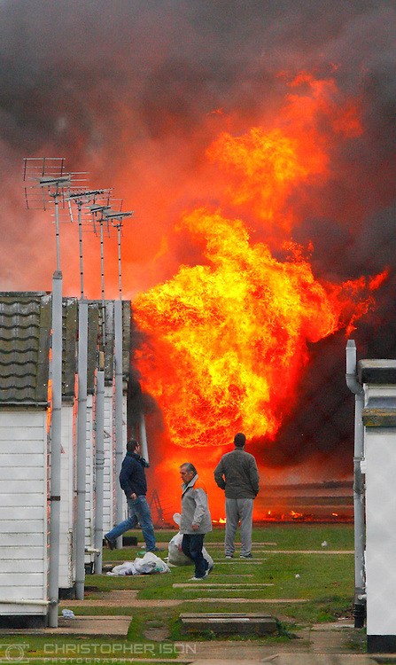Inmates evacuate their accommodation units as fires are ignited by prisoners at HM Prison Ford near Arundel, West Sussex. Around 40 inmates smashed windows and set light to the gymnasium at the open prison after midnight.