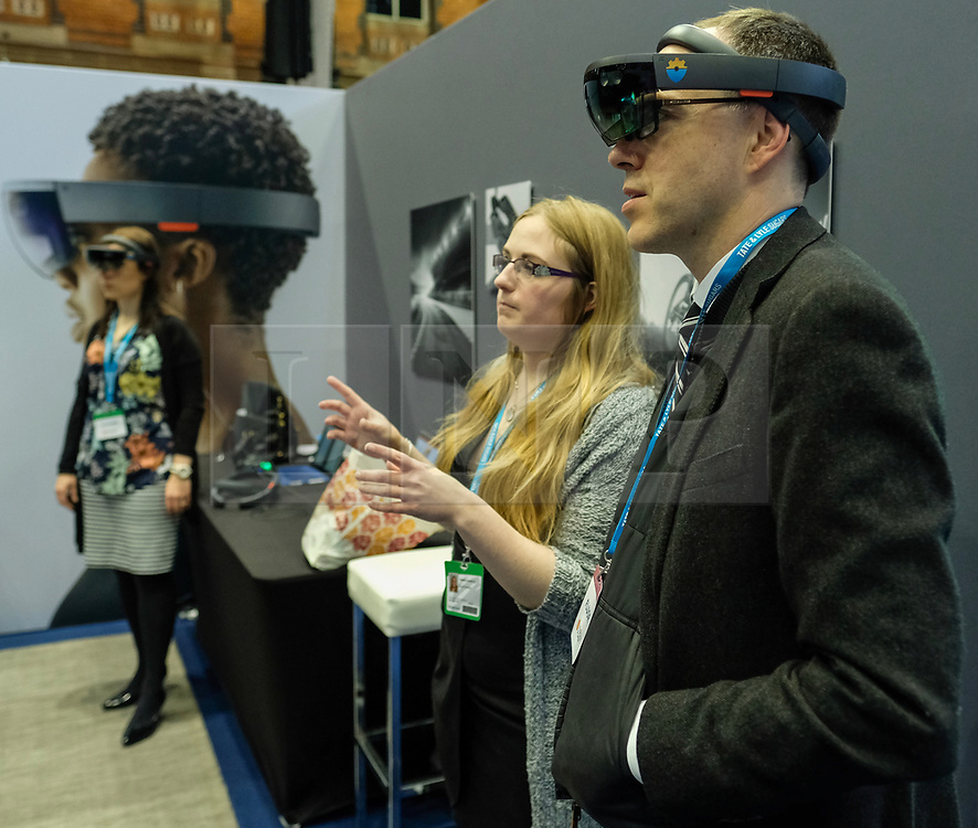 (c) Licensed to London News Pictures. <br /> 02/10/2017<br /> Manchester, UK<br /> <br /> A man is shown virtual headwear at a stand at the Conservative Party Conference held over four days at the Manchester Central Convention Complex.<br /> <br /> Photo Credit: Ian Forsyth/LNP