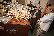 Reception at Lobmeyr/Vienna to celebrate the restauration of 11 crystal chandeliers Lobmeyr had created for the foyer and auditorium of New York's Metropolitan Opera, in 1966..Andreas Rath of Lobmeyr explaining the process to Brigitte Jank (President of Vienna's Chamber of Commerce): The Sputnik-like steel structures with 51.000 individual crystals are completely dismantled, cleaned, and re-built from the ground, while many missing crystals and damaged or outdated parts are being replaced. This takes approximatley one month..Lobmeyr's prestigeuos client list includes H.R.H. Queen Elisabeth II., the Sultan of Brunei, Arnold Schwarzenegger and many others.