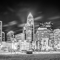 Charlotte cityscape at night black and white photo with downtown city buildings and Romare Bearden Park. Charlotte is a major city in North Carolina in the Eastern United States.