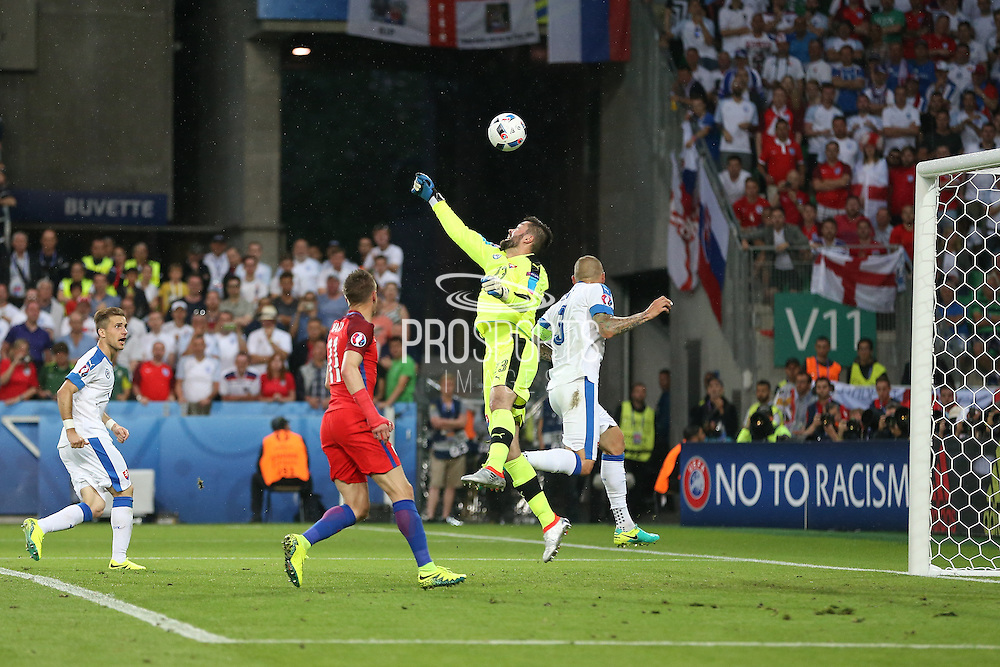 Slovakia Goalkeeper Matus Kozacik punches the ball from England Forward Jamie Vardy during the Euro 2016 Group B match between Slovakia and England at Stade Geoffroy Guichard, Saint-Etienne, France on 20 June 2016. Photo by Phil Duncan.