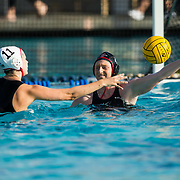 11 February 2018: The San Diego State  women's water polo team competes in day two of the Triton Invitation on the campus of UCSD. San Diego State Aztecs utility Emily Bennett (13) blocks a pass by CSUN Matadors Lindsey Garcia (11) in the first quarter. The Aztecs took on the #23 CSUN Matadors Sunday morning and came away with a 8-5 win.<br /> More game action at www.sdsuaztecphotos.com