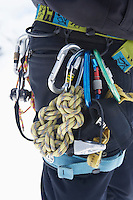 Hiker's belt filled with safety ropes mid section