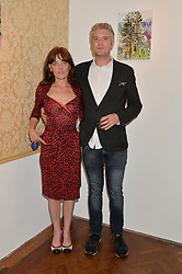 WILLIAM ROPER-CURZON and LIZZIE HARTNOLL at a private view of William Roper-Curzon's latest paintings held at Julian Hartnoll, 37 Duke Street, St.James's, London on 9th October 2014.