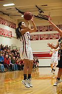 CVU's Amanda Daniels (14) takes a shot during the girls basketball game between the Essex Hornets and the Champlain Valley Union Redhawks at CVU high school on Tuesday night January 26, 2016 in Hinesburg. (BRIAN JENKINS/for the FREE PRESS)