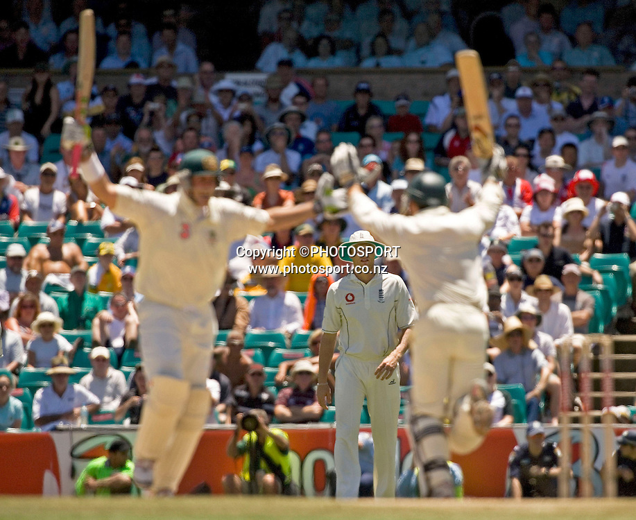 Losing captain Andrew Flintoff watches as Matthew Hayden and Justin Langer celebrate winning the series 5-0 in the fifth Test Match between Australia and England at the SCG in Sydney, on 5 January, 2007. *NZ EDITORIAL USE ONLY**NO AGENTS**<br /> <br /> 050107 ashes cricket