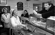Pic by HOWARD BARLOW..FISH & CHIP SHOP POET PETER STREET RECITING HIS WORKS AT 'SHIRLEYS PLAICE' IN LEIGH, WIGAN