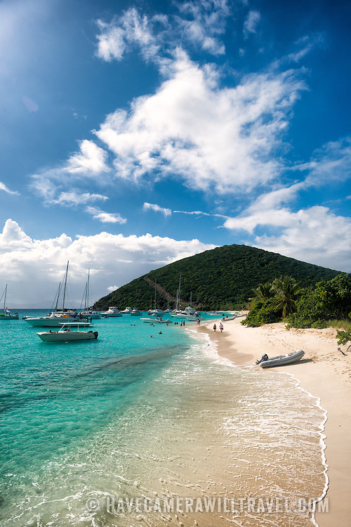 The tropical sandy beach at White Bay on Jost Van Dyke in the British Virgin Islands in the Caribbean. The beach is a popular day stop for boaters.